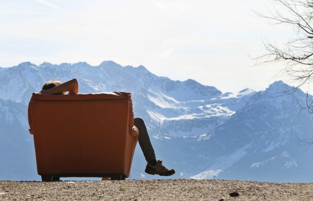 A hiker takes a rest in the sunshine, in an armchair near the Hochbichl alpine hut near Ofterschwang, Germany, on March 21, 2014. (Karl-Josef Hildenbrand/AFP/Getty Images)